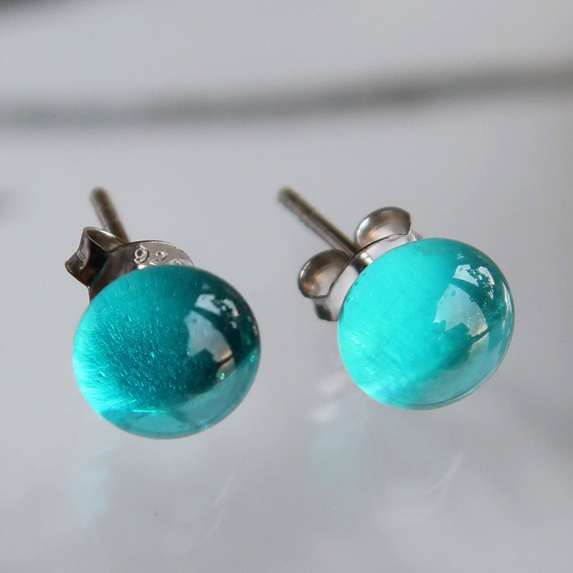 Limpid earring button Ocean